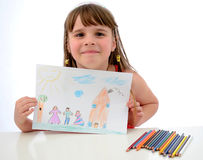 Child girl shows the draw. Happy child girl shows the draw with happy family stock photos