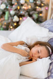 Child girl sleep in her bed in Christmas morning Royalty Free Stock Image
