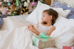 Child girl sleep in her bed in Christmas morning Royalty Free Stock Photography
