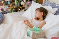 Child girl sleep in her bed in Christmas morning Stock Photos