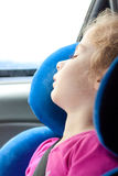 Child girl sleeping while traveling in a car seat Royalty Free Stock Images