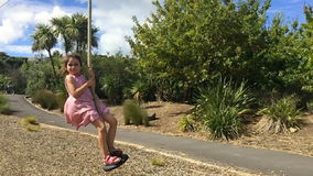 Child girl slide on flying fox stock footage