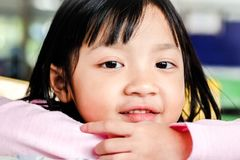 Child girl smiling brightly with happiness royalty free stock image