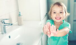 Child Girl Smiling Face Wahing And Showing Clean Hands Stock Photo