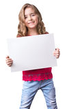 Child girl smiling hold white sheet blank isolated. Stock Photos