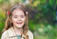 Child girl smiling outdoors empty space background. royalty free stock photos
