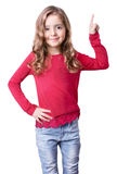 Child girl sniling pointing with finger isolated. Royalty Free Stock Photography