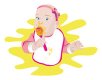Child girl with a spoon and a napkin Royalty Free Stock Photography