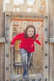 Girl on the sports wooden Playground. Child, girl on the sports wooden Playground royalty free stock photo