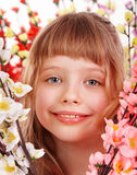 Child girl on spring flower. Royalty Free Stock Photos