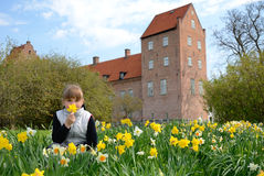 Child girl in spring park. Cute child girl in Swedish park close to the old castle Royalty Free Stock Images