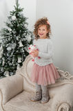 Child girl stand near christmas tree Stock Image
