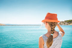 Child girl standing back by the sea - holiday Stock Photos
