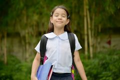 Child Girl Student With Eyes Closed Wearing Uniform. An attractive and asian person royalty free stock photo