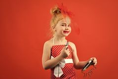 Child girl in stylish dress, makeup. Retro girl fashion with cosmetics, beauty. Fashion and beauty, pinup style. Childhood. Makeup retro look and hairdresser stock images