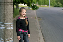 Child girl suburban street Royalty Free Stock Photography