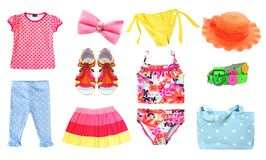 Child girl summer clothes set isolated. Beach summer baby clothes isolated.Child clothing set royalty free stock photography