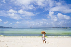 Child girl in summer hat on tropical sea background Royalty Free Stock Image