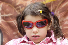 Child girl in sunglasses Stock Images