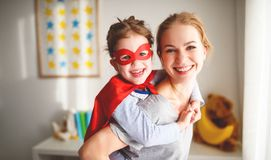 Child girl in a super hero costume with mask and red cloak Royalty Free Stock Photography