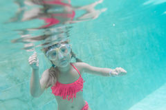 Child girl swimming underwater Stock Photo