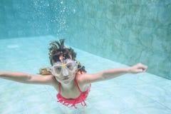 Child girl swimming underwater Stock Photos
