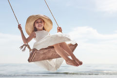 Child girl on swing Royalty Free Stock Photos
