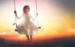 Child girl on swing Royalty Free Stock Image