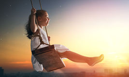 Child girl on swing Stock Photography