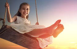 Child girl on swing Royalty Free Stock Image