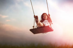 Child girl on swing Stock Photos