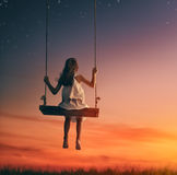 Child girl on swing Royalty Free Stock Photography