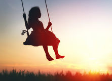 Child girl on swing Stock Image