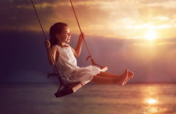 Child girl on swing Royalty Free Stock Images