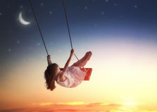 Child girl on swing Royalty Free Stock Photo