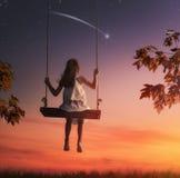 Child girl on swing Stock Image