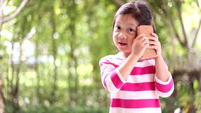 Child, Girl, Talking on Smartphone or Cell Phone stock video footage