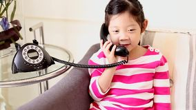 Child, Girl, Talking on Traditional Phone with Happiness stock video footage