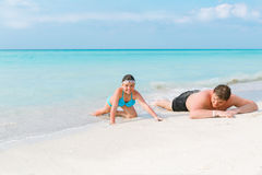 Child girl and teenage boy relaxing and enjoying their leisure time on Cuban sunny white sand beach Royalty Free Stock Images