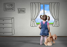 Child girl with toy bear look in drawn window, dream concept Stock Photography