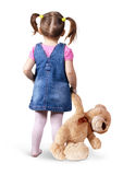 Child girl with toy bear on white, back view Stock Photos
