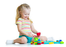 Child girl with toy blocks isolated Stock Image