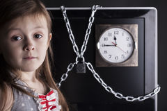 Child, girl, TV or comhuter closed with chain lock, clock Royalty Free Stock Images