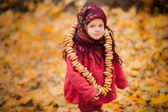 Child girl in Ukrainian folk scarf Royalty Free Stock Photo