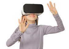 Child girl using virtual reality goggle, isolated on white Royalty Free Stock Photos