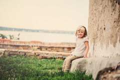 Child girl on vacation in Piran, Slovenia, near stone wall Royalty Free Stock Images
