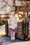 Child girl on the walk near old country well Royalty Free Stock Photography