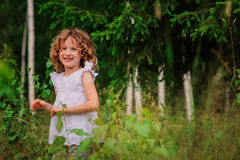 Child girl on the walk in summer forest, nature exploration with kids. Cute child girl on the walk in summer forest, nature exploration with kids Royalty Free Stock Photography