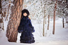 Child girl on the walk in winter snowy forest Royalty Free Stock Photography