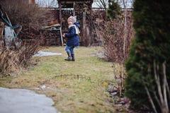 Child girl walking in early spring garden Stock Photo